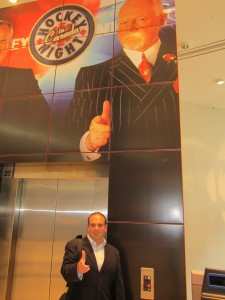 Tony Vella poses with huge wall portrait of Don Cherry at CBC Toronto building on Front St, Toronto