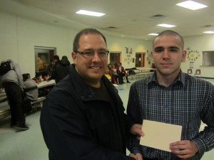 Constable Ryan Drapack presents Golf Program Graduate Gregory Letounov $500 Cheque Towards His Ryerson University Education